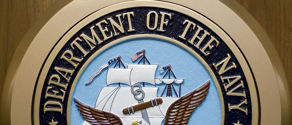 The US Department of the Navy logo hangs