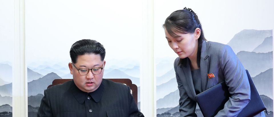 North Korea's leader Kim Jong Un (L) signs the guest book next to his sister Kim Yo Jong (R) during the Inter-Korean summit with South Korea's President Moon Jae-in at the Peace House building on the southern side of the truce village of Panmunjom on April 27, 2018. (KOREA SUMMIT PRESS POOL/AFP via Getty Images)