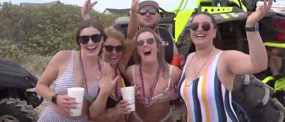 Go Topless Beach Weekend (Credit: Screenshot/ http://www.12newsnow.com/video/news/local/dozens-of-arrest-made-at-go-topless-jeep-weekend-in-galveston-co/502-2f5d81be-09af-4359-b32a-17ad2694d58b?jwsource=cl)