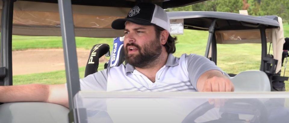 Guys Playing Golf (Credit: Screenshot/YouTube https://www.youtube.com/watch?v=QSFEeEqRrPE)