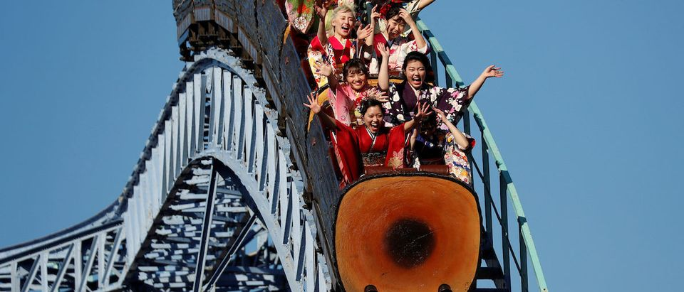 Japanese women wearing kimonos ride a roller coaster during their Coming of Age Day celebration ceremony at Toshimaen amusement park in Tokyo, Japan January 14, 2019. REUTERS/Issei Kato
