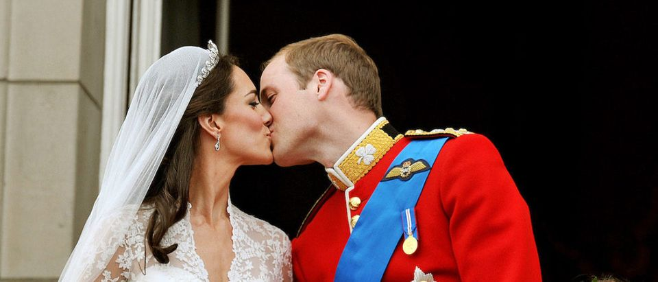 Prince William and his wife Kate Middleton, who has been given the title of The Duchess of Cambridge, kiss on the balcony of Buckingham Palace, London, following their wedding at Westminster Abbey. PRESS ASSOCIATION Photo. Picture date: Friday April 29, 2011. See PA story WEDDING Lead. Photo credit: Getty Images John Stillwell/PA Wire