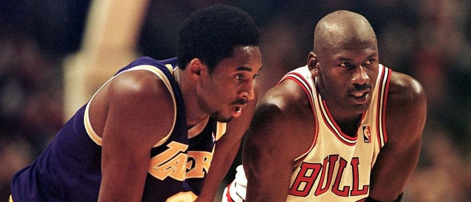 CHICAGO, UNITED STATES: Los Angeles Lakers guard Kobe Bryant(L) and Chicago Bulls guard Michael Jordan(R) talk during a free-throw attempt during the fourth quarter 17 December at the United Center in Chicago. Bryant, who is 19 and bypassed college basketball to play in the NBA, scored a team-high 33 points off the bench, and Jordan scored a team-high 36 points. The Bulls defeated the Lakers 104-83. (Photo credit: VINCENT LAFORET/AFP via Getty Images)