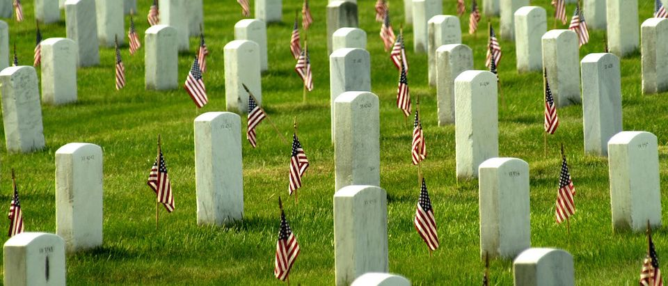 American flags adorn each grave in Arlington National Cemetary in honor of Memorial Day May 27, 2002 in Arlington, VA. Thousands of tourists, veterans, armed services personnel, and relatives visited the cemetery in recognition of Memorial Day. (Photo by Stefan Zaklin/ Getty Images)