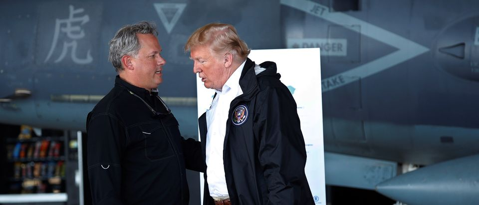 U.S. President Trump talks with North Carolina Lt Governor Forest at briefing on Hurricane Florence in Havelock, North Carolina
