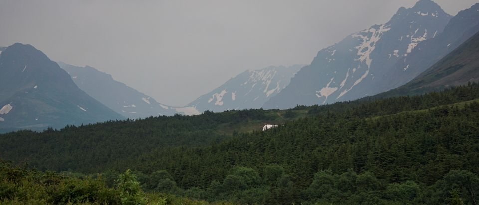 A general view of the mountain valley obscured by smoke taken from the Glen Alps trailhead of Chugach State Park in Anchorage