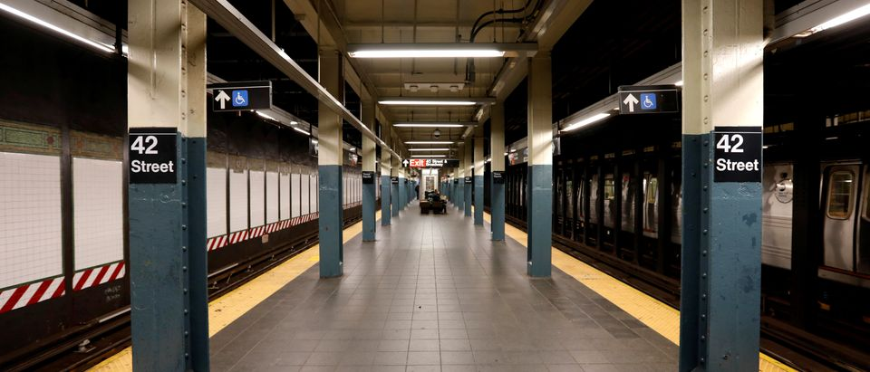 A nearly empty subway platform is seen at the 42nd Street subway station during the coronavirus outbreak in New York City