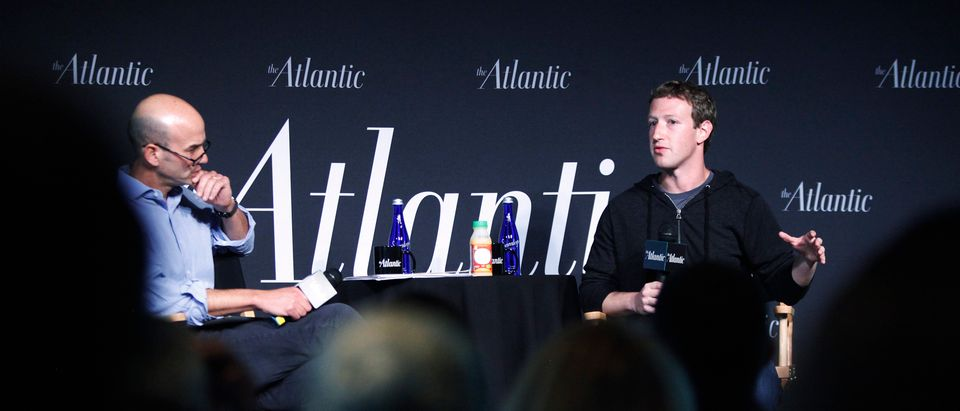 Facebook CEO Mark Zuckerberg takes his seat for an onstage interview with James Bennet of the Atlantic Magazine in Washington