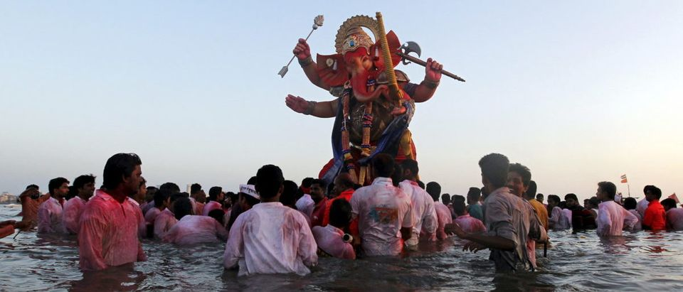 Devotees carry an idol of Hindu elephant god Ganesh, the deity of prosperity, for immersion into the Arabian Sea on the last day of the Ganesh Chaturthi festival in Mumbai