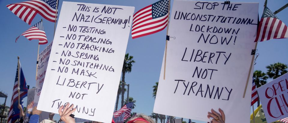 Protests during the global outbreak of the coronavirus disease (COVID-19), in Huntington Beach, California