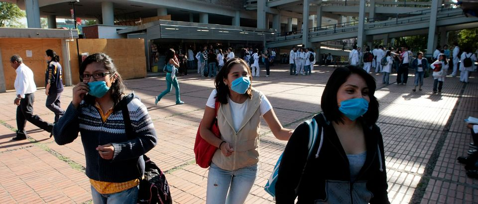Students wearing surgical masks arrive at the National Autonomous University of Mexico (UNAM) after it was reopened, in Mexico City