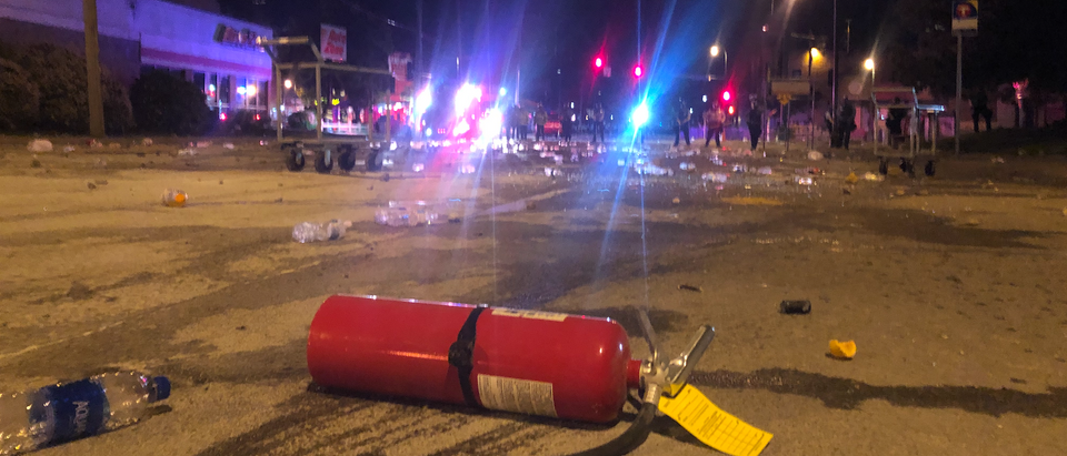 a discharged fire extinguisher lays in the street at the Minneapolis riot. (Kyle Hooten)