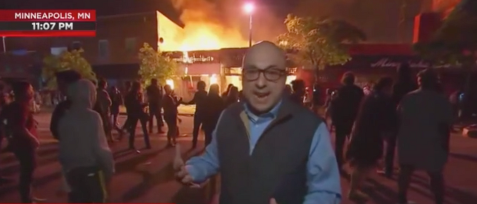 MSNBC's Ali Velshi stands in front of a burning building while reporting that the riots are mostly peaceful protests in Minneapolis. (Screenshot MSNBC, The Rachel Maddow Show)