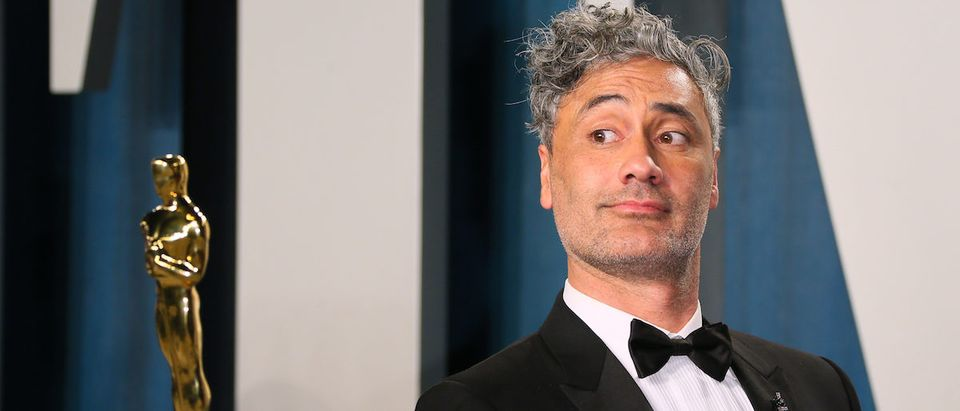 """New Zealand director-actor Taika Waititi poses with his award for Best Adapted Screenplay for """"Jojo Rabbit"""" as he attends the 2020 Vanity Fair Oscar Party following the 92nd Oscars at The Wallis Annenberg Center for the Performing Arts in Beverly Hills on February 9, 2020. (Photo by JEAN-BAPTISTE LACROIX/AFP via Getty Images)"""