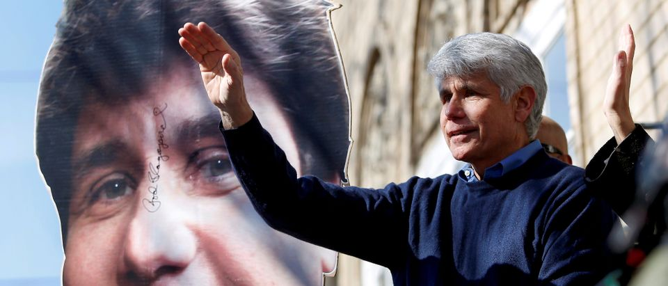 Rod Blagojevich, the ex-Illinois governor convicted of trying to peddle Barack Obama's vacated U.S. Senate seat, waves as he exits his home. REUTERS/Joshua Lott