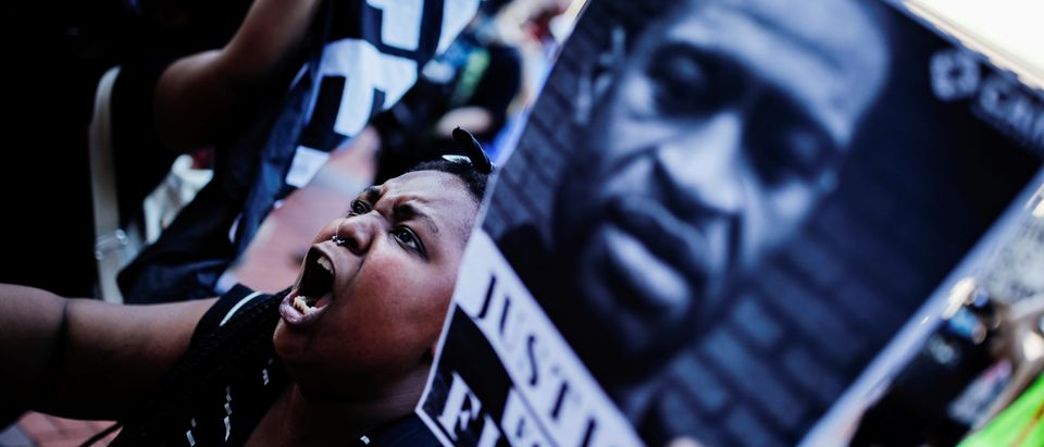 A protester reacts while gathering with others outside the city hall after a white police officer was caught on a bystander's video pressing his knee into the neck of African-American man George Floyd, who later died at a hospital, in Minneapolis, Minnesota, U.S., May 28, 2020. REUTERS/Carlos Barria