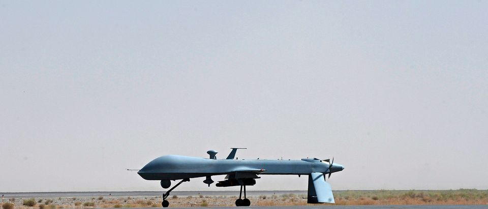 A U.S. Predator unmanned drone armed with a missile stands on the tarmac of Kandahar military airport