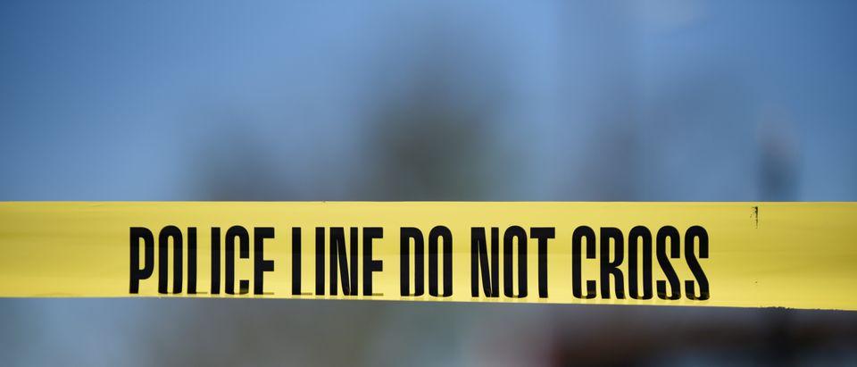 Crime scene tape blocks off an area designated for the media at the scene of a blast at a FedEx facility in Schertz, Texas