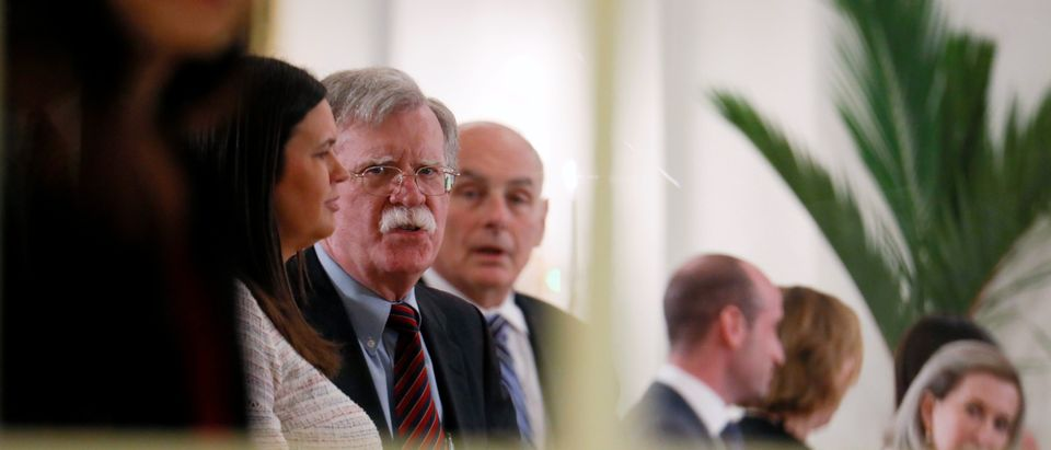White House Press Secretary Sarah Huckabee Sanders, U.S. National Security Advisor John Bolton, White House Chief of Staff John Kelly and other U.S. officials are seen at the Istana in Singapore