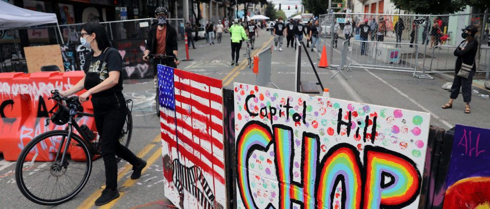 Demonstrators at the self-proclaimed Capitol Hill Autonomous Zone (CHAZ) during a protest against racial inequality and call for defunding of Seattle police, in Seattle