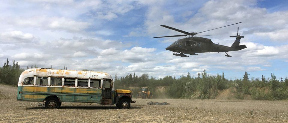 """Alaska Army National Guard helicopter hovers near """"Bus 142"""" near Stampede Road"""