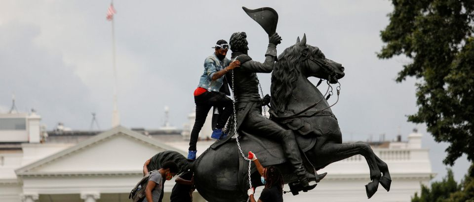 FILE PHOTO: Protestors attach a chain to the statue of U.S. President Andrew Jackson in front of the White House in an attempt to pull it down in Washington