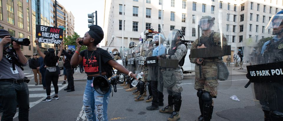 Protestor demands other protestors respect the police because they have been respectful of their protest. (Photo: Kaylee C. Greenlee, Daily Caller News Foundation)