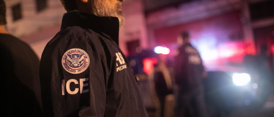 GUATEMALA CITY, GUATEMALA - MAY 29: An ICE agent with U.S. Homeland Security Investigations (HSI), watches as Guatemalan police investigate the scene after detaining a suspected human trafficker on May 29, 2019 in Guatemala City. Homeland Security agents accompanied Guatemalan police on an early morning raid, the first since Acting U.S. Homeland Security Secretary Kevin McAleenan signed an agreement with his Guatemalan counterparts, increasing cooperation on human and drug smuggling. McAleenan is on a four-day trip to Guatemala. (Photo by John Moore/Getty Images)