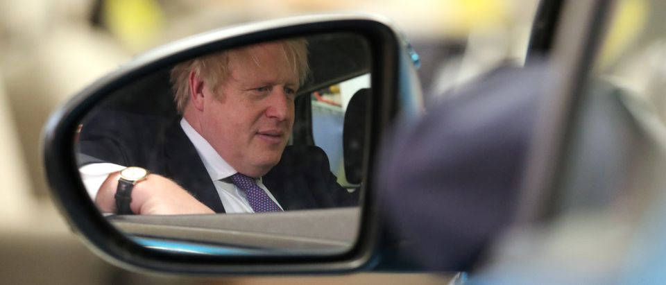 SUNDERLAND, ENGLAND - JANUARY 31: Britain's Prime Minister Boris Johnson is reflected in a car mirror as he visits The Industry Centre at University of Sunderland on Brexit day on January 31, 2020 in Sunderland, England. (Photo by Scott Heppell - WPA Pool/Getty Images)