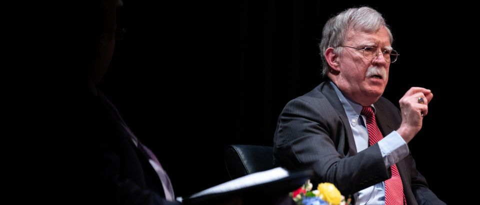 Former National Security adviser John Bolton (R) speaks on stage during a public discussion at Duke University in Durham, North Carolina on February 17, 2020. - Bolton was invited to the school to discuss national security weeks after he was thought of as a key witness in the impeachment trial of President Donald Trump. (Photo by LOGAN CYRUS/AFP via Getty Images)