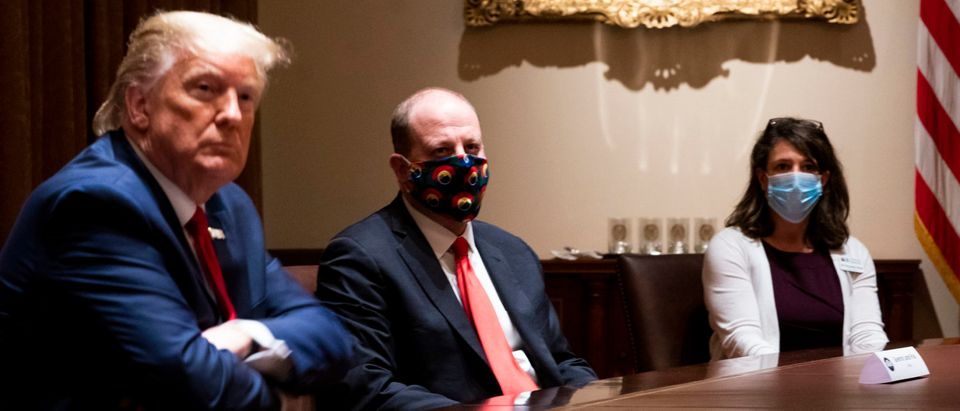 WASHINGTON, DC - MAY 13: Colorado Governor Jared Polis (C) wears a face mask as U.S. President Donald Trump makes remarks during a meeting in the Cabinet Room of the White House, May 13, 2020 in Washington, DC. (Photo by Doug Mills-Pool/Getty Images)