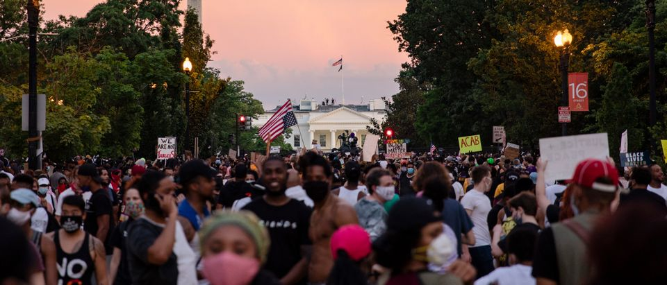 Protesters gather along the recently rename Black Lives Matter Plaza near the White House as the sun sets during continued demonstrations on June 6, 2020 in Washington, DC. (Samuel Corum/Getty Images)