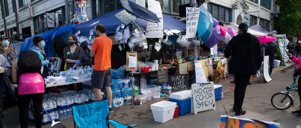 SEATTLE, WA - JUNE 12: Free water, masks and food are available at the No-Cop Co-op in an area dubbed the Capitol Hill Autonomous Zone (CHAZ) on June 12, 2020 in Seattle, Washington. The area had been the site of recent clashes between the Seattle Police Department and Black Lives Matters demonstrators advocating against police brutality. After the Seattle Police Department East Precinct was boarded up and officers left last week demonstrators turned the area into a street scene with free food, music, onsite medics and no cars. Protests demanding police reforms sparked by the death of George Floyd, who died in police custody two weeks ago, have spread worldwide. (Photo by Karen Ducey/Getty Images)