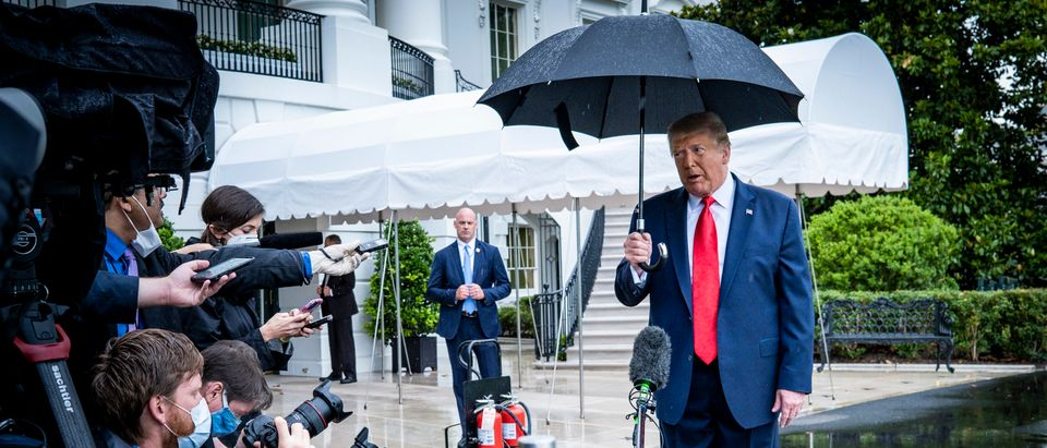 WASHINGTON, DC - JUNE 20:President Donald Trump stops to speak to the media in the rain on the South Lawn of the White House as he prepares to depart aboard Marine One for a rally in Tulsa, OK, on June 20, 2020 in Washington, DC. The rally is Trump's first in months since the coronavirus lockdown and his campaign acknowledged that six staff members had tested positive for the virus during routine screening. (Photo by Pete Marovich/Getty Images)