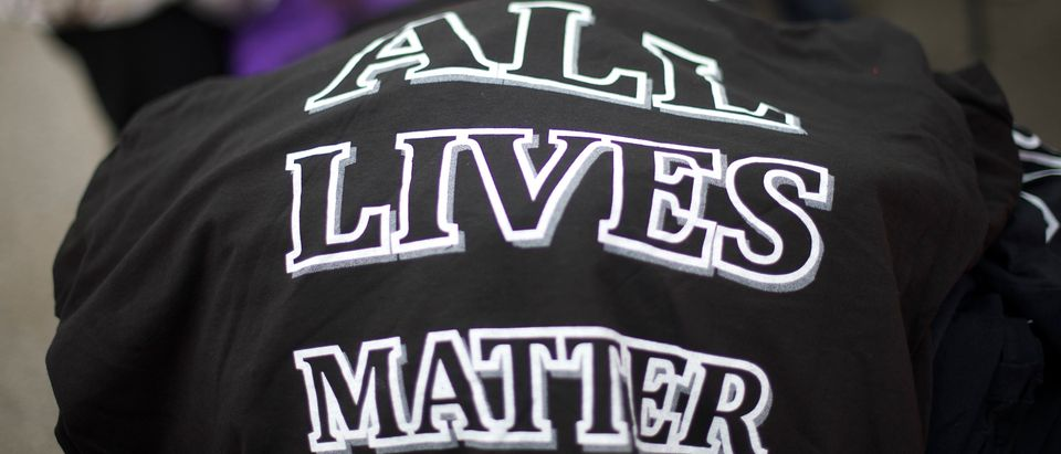 "BALTIMORE, MD - APRIL 25: T-shirts stating ""All Lives Matter"" are on sale for $10 each outside City Hall before a protest in honor of Freddie Gray April 25, 2015 in Baltimore, Maryland. Gray, 25, was arrested for possessing a switch blade knife April 12 outside the Gilmor Homes housing project on Baltimore's west side. According to his attorney, Gray died a week later in the hospital from a severe spinal cord injury he received while in police custody. (Photo by Mark Makela/Getty Images)"