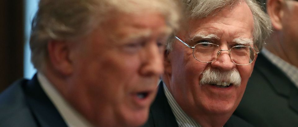 WASHINGTON, DC - APRIL 09: National Security Advisor John Bolton (R), listens to U.S. President Donald Trump as he speaks about the FBI raid at lawyer Michael Cohen's office, while receiving a briefing from senior military leaders regarding Syria, in the Cabinet Room, on April 9, 2018 in Washington, DC. The FBI raided the office of Michael Cohen on Monday as part of the ongoing investigation into the president's administration. (Photo by Mark Wilson/Getty Images)