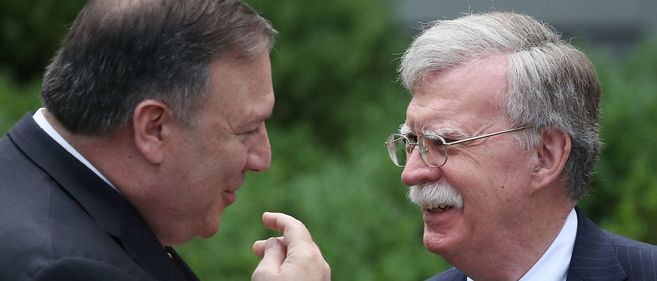 WASHINGTON, DC - JUNE 07: Secretary of State Mike Pompeo (L) talks with White House National Security Advisor John Bolton before a news conference with U.S. President Donald Trump and Japanese Prime Minister Shinzo Abe, in the Rose Garden at the White House, on June 7, 2018 in Washington, DC. The two leaders met to discuss next week's summit with North Korea. (Photo by Mark Wilson/Getty Images)