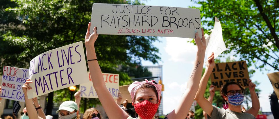 Protesters rally against racial inequality and the police shooting death of Rayshard Brooks, in Atlanta
