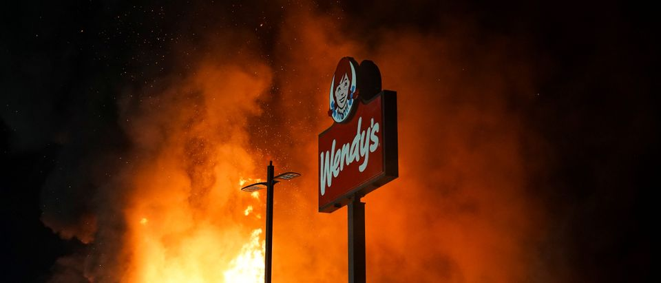 A Wendy's burns following a rally against racial inequality and the police shooting death of Rayshard Brooks, in Atlanta