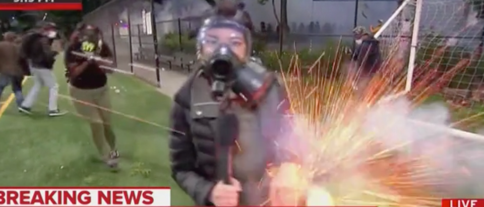 An NBC News correspondent got hit with fireworks Monday evening while reporting in Seattle. (Screenshot MSNBC, The Rachel Maddow Show)