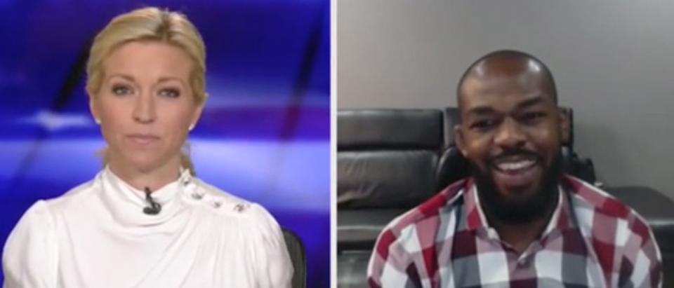 "UFC star Jon Jones appears with Ainsley Earhardt on ""Fox and Friends."" Screenshot/Fox News"