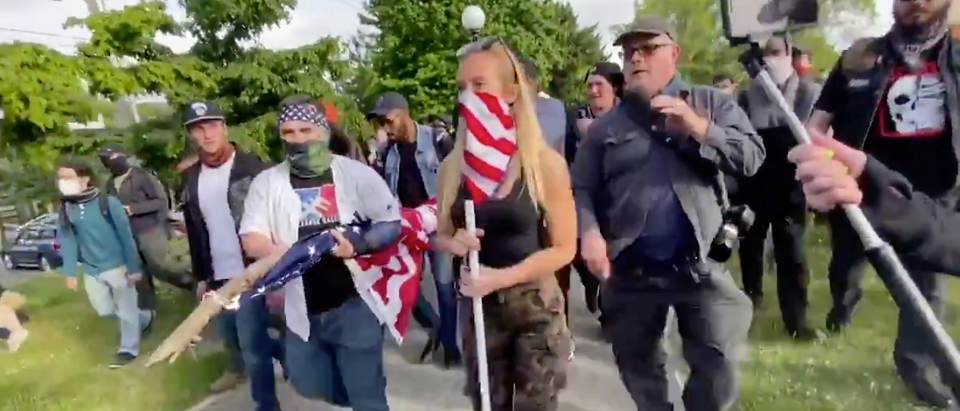 Flag-bearing Americans sparked backlash as they tried to walk through Seattle's CHAZ. (Screenshot Twitter Shelby Talcott)