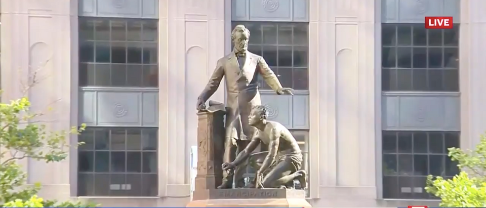 Abraham Lincoln and free black man statue in Boston/screenshot via WCVB5