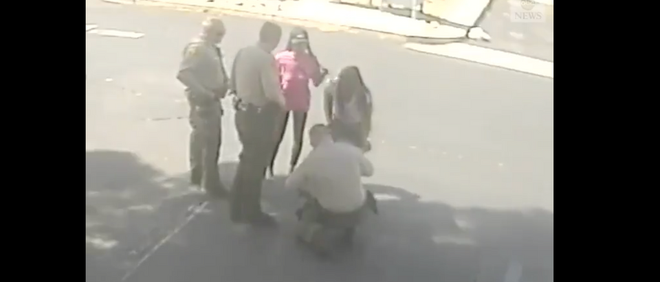A California cop saved a choking baby during protests. (Screenshot Twitter ABC News)