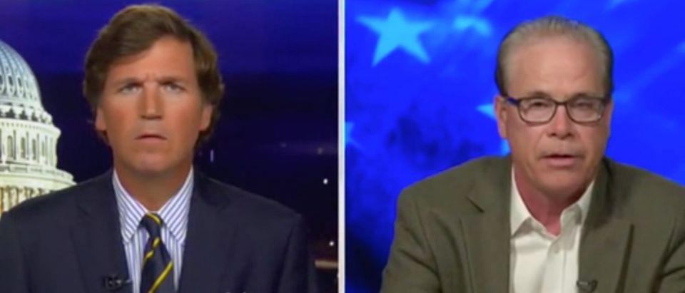 Tucker Carlson speaks with Republican Indiana Sen. Mike Braun. Screenshot/Fox News