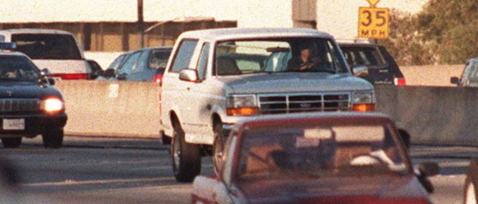LOS ANGELES - JUNE 17: Motorists wave as police cars pursue the Ford Bronco (white, R) driven by Al Cowlings, carrying fugitive murder suspect O.J. Simpson, on a 90-minute slow-speed car chase June 17, 1994 on the 405 freeway in Los Angeles, California. Simpson's friend Cowlings eventually drove Simpson home, with Simpson ducked under the back passenger seat, to Brentwood where he surrendered after a stand-off with police. (Photo credit: MIKE NELSON/AFP via Getty Images)