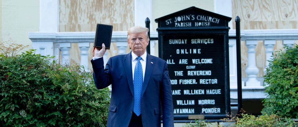 TOPSHOT - US President Donald Trump holds a Bible while visiting St. John's Church across from the White House after the area was cleared of people protesting the death of George Floyd June 1, 2020, in Washington, DC. - US President Donald Trump was due to make a televised address to the nation on Monday after days of anti-racism protests against police brutality that have erupted into violence.