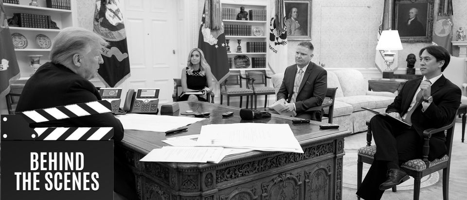 President Donald Trump, Kayleigh McEnany, Geoff Ingersoll, and Christian Datoc sit down for an interview in the Oval Office (White House Photo by Tia Dufour, Daily Caller)