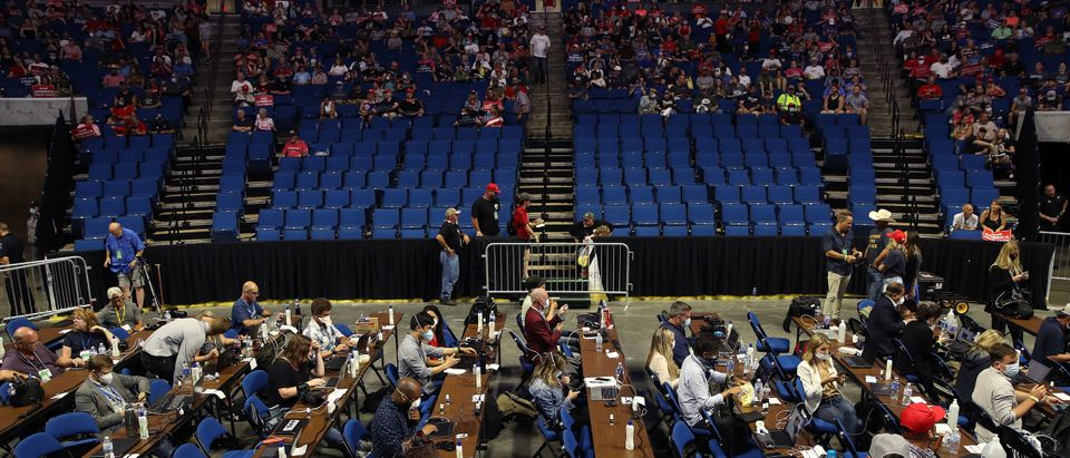 Members of the media sit at tables during a campaign rally for U.S. President Donald Trump at the BOK Center, June 20, 2020 in Tulsa, Oklahoma. Trump is holding his first political rally since the start of the coronavirus pandemic at the BOK Center on Saturday while infection rates in the state of Oklahoma continue to rise. (Photo by Win McNamee/Getty Images)
