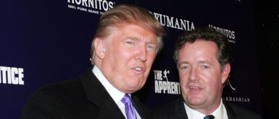 "NEW YORK - NOVEMBER 10: Donald Trump (L) and Piers Morgan celebrate Kim Kardashian's appearance on ""The Apprentice"" at Provacateur on November 10, 2010 in New York, New York. (Photo by John W. Ferguson/Getty Images)"